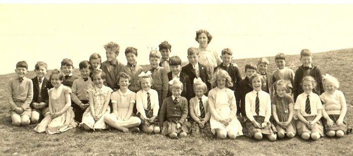 Hilton School circa 1959. Back Row, left to right, as viewer looks. not known, William Harrison, David Vass, not known, Tommy Mackenzie, Douglas Vass, Ian Horn, James Allan, David Wood, not known, not known, Peggy Ross [teacher], David Cupar Vass, not known, Robert Renz, not known, Shorus MacKay. Front Row. Jean MacKay, Sheila MacKay, not known, Sandra Ross, Moira Skinner, not known, Audrey Campbell, Oona Ross, Sandra MacLennan, Ishbel Mackenzie, Margaret Skinner.